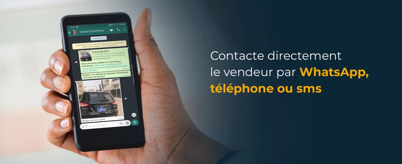 """Main avec un téléphone mobile et la phrase : """"Contacte directement le vendeur par WhatsApp, téléphone ou sms."""""""